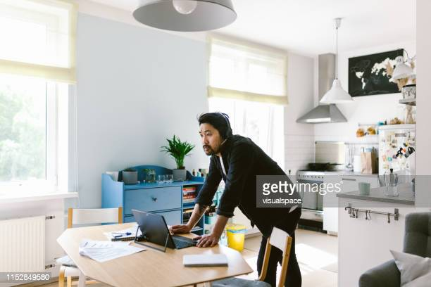 asian man having a video conference call - east asian ethnicity stock pictures, royalty-free photos & images