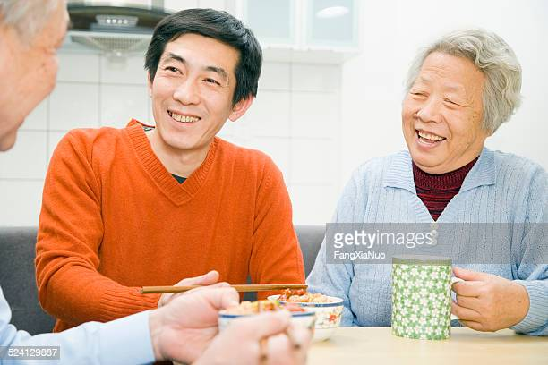 Asian man having dinner with parents