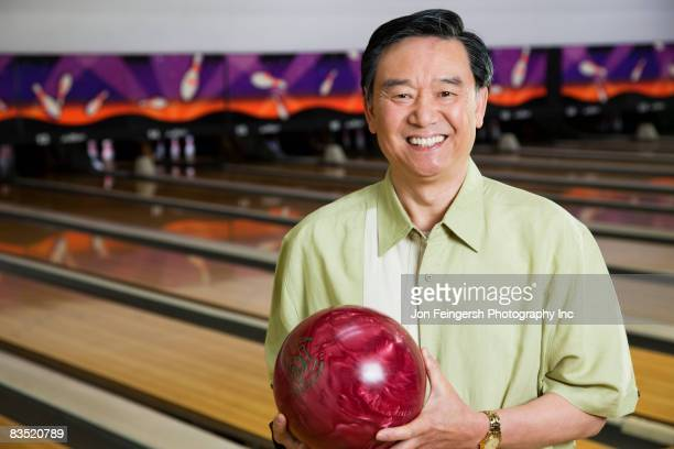 asian man in bowling alley - ボーリング場 ストックフォトと画像