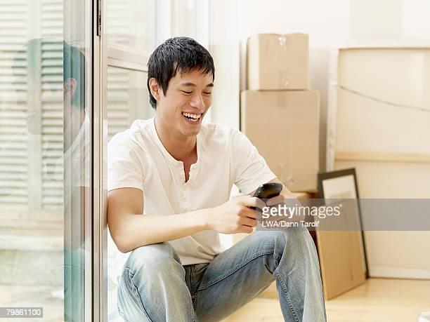 Asian man looking at cell phone