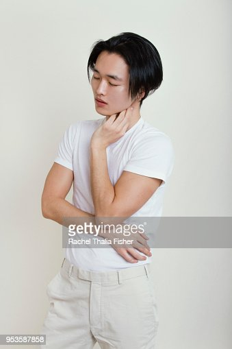 Asian man looking pensive in studio portrait