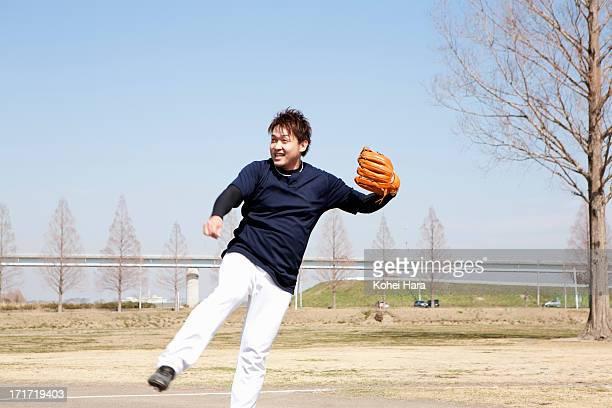 asian man playing baseball - キャッチャーミット ストックフォトと画像