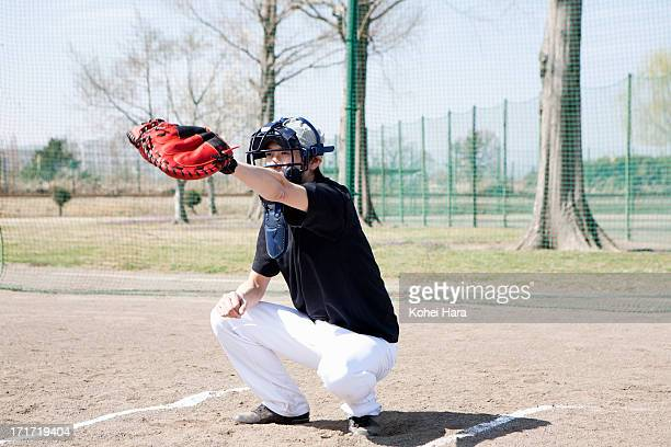 asian man playing baseball - baseball catcher stock pictures, royalty-free photos & images