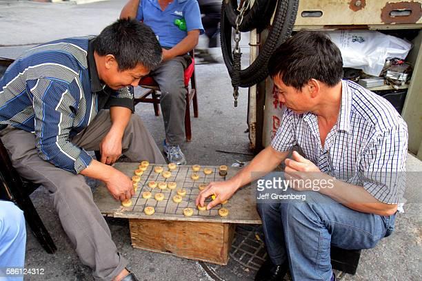 Asian man playing board game Xiangqi Chinese Chess