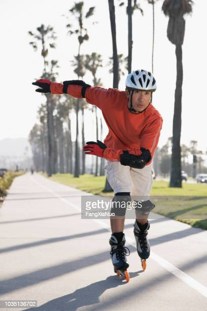 asian man rollerblading - inline skate stock photos and pictures