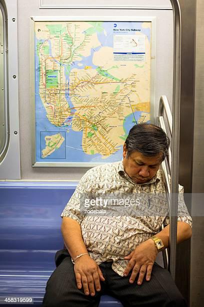 Asian man Sleeping on New York Subway