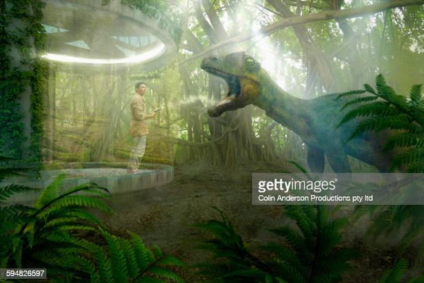 Asian man standing on patio in prehistoric jungle