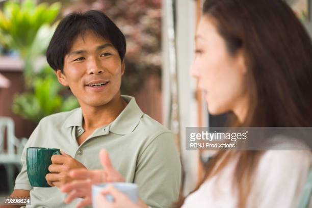 Asian man talking to girlfriend
