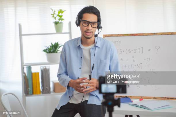 asian man teaching mathematics online,smiling asian woman teacher speaking recording vlog or mathematics lesson class online for homeschooling - live broadcast stock pictures, royalty-free photos & images