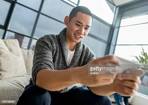 Asian man texting