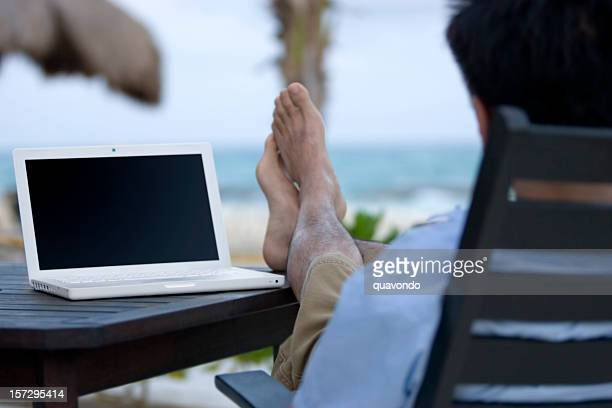 Asian Man Using Laptop Outside at Beach, Copy Space
