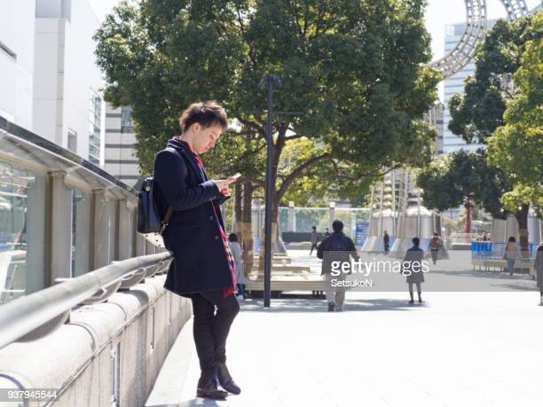 asian man waiting for his friends - kanagawa prefecture stock pictures, royalty-free photos & images
