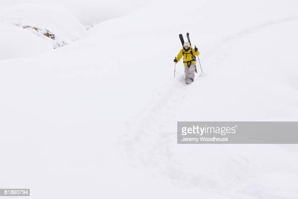 Asian man walking in snow