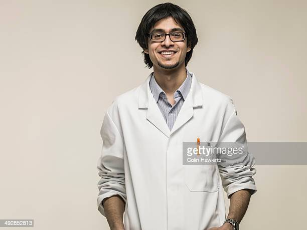 Asian man wearing laboratory coat