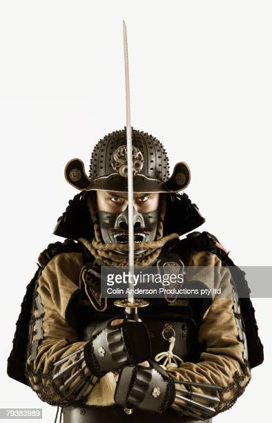Asian man wearing samurai armor