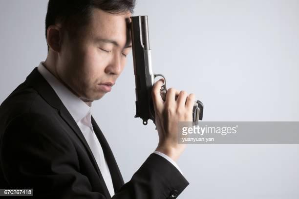 Asian man with gun