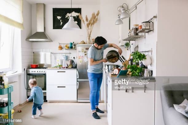 asian man with his child making ramen soup at home - nordic countries stock pictures, royalty-free photos & images