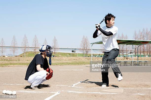 asian men playing baseball - batting sports activity stock pictures, royalty-free photos & images