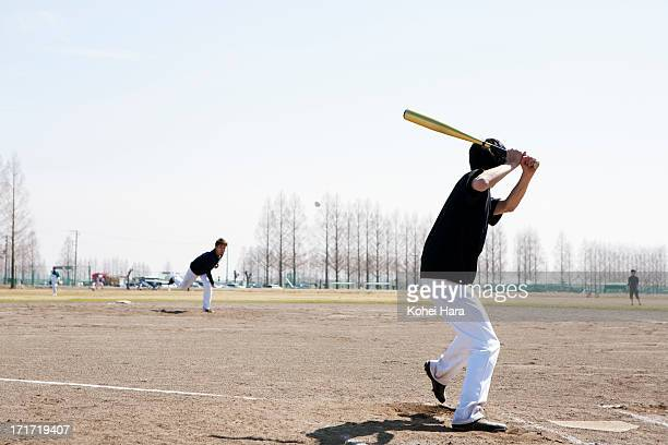 asian men playing baseball - batear fotografías e imágenes de stock