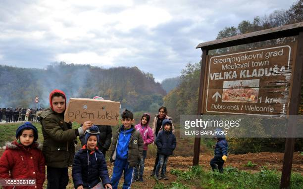 Asian migrants camp on the road in the vicinity of Maljevac border crossing with neighboring Croatia near NorthernBosnian town of Velika Kladusa on...