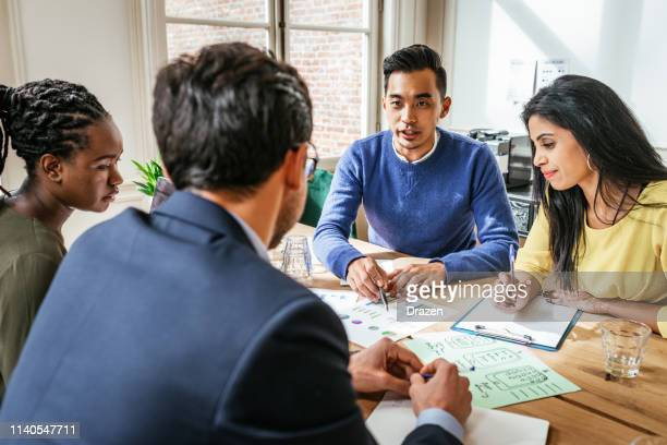 asian millennial investors establishing partnership with african and european partners. - responsible business stock photos and pictures
