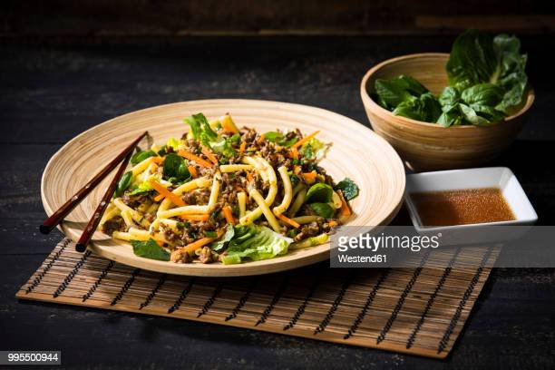 asian mincemeat salad with macaroni, ginger, chili, garlic, carrot, spring onion, soy lemon sauce - asian food stock pictures, royalty-free photos & images