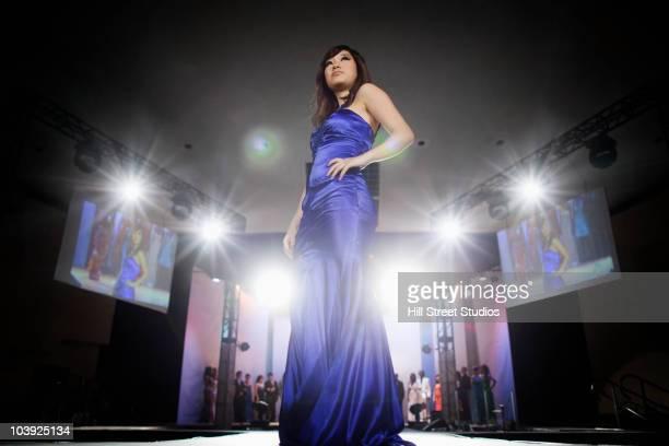 Asian model on fashion runway