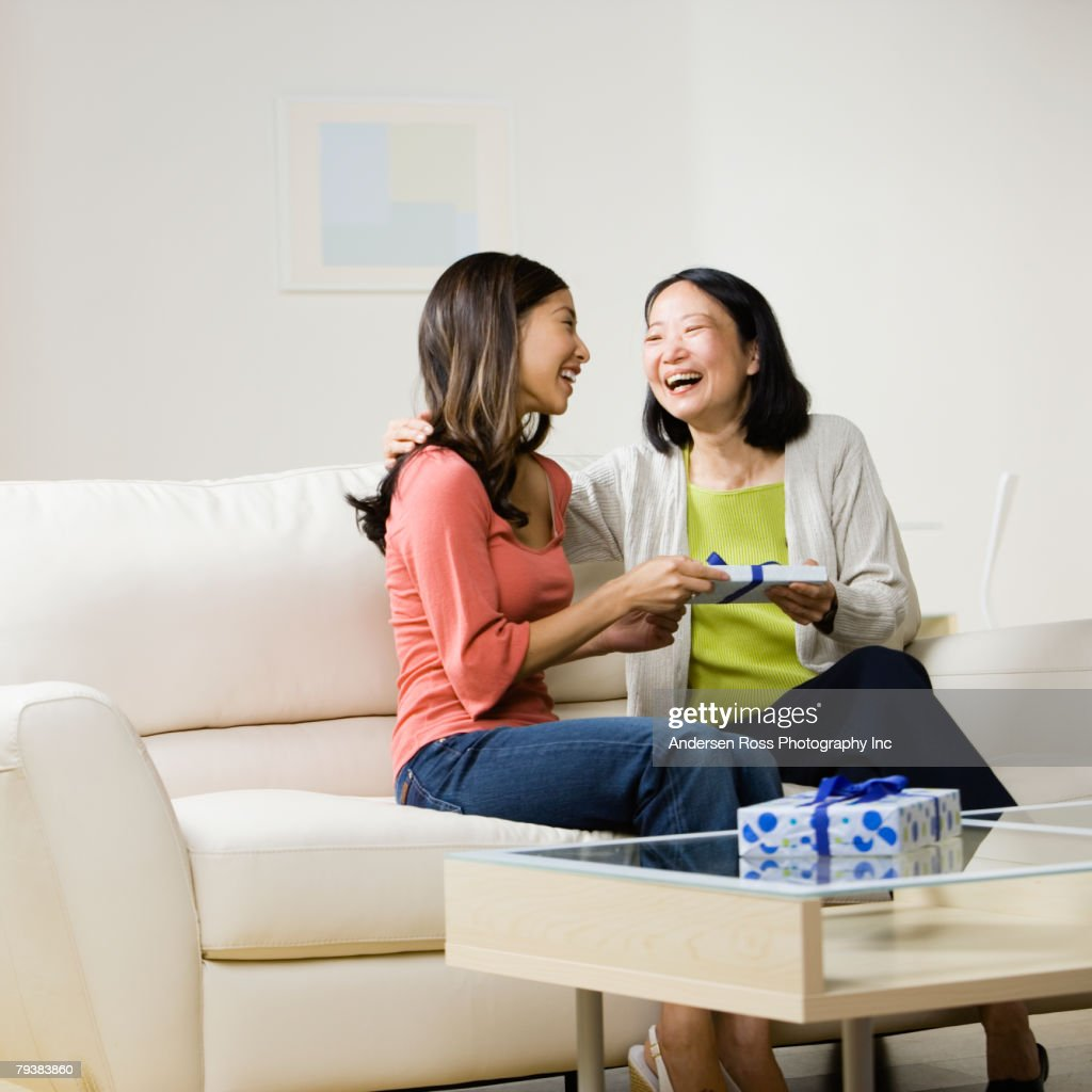 Asian mother and adult daughter exchanging gift : Stock Photo