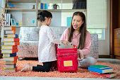 asian mother daughter packing backpacks to