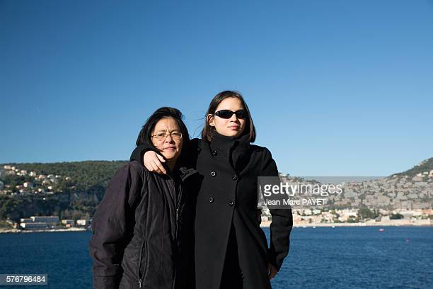 Asian mother and her daughter in front of the sea