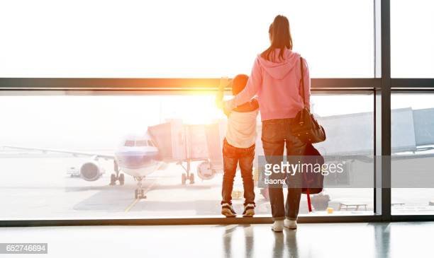 Asian mother and son at airport