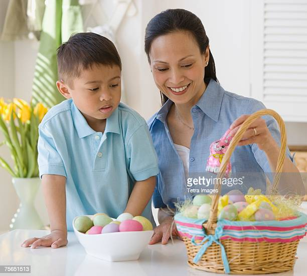 Asian mother and son making Easter basket