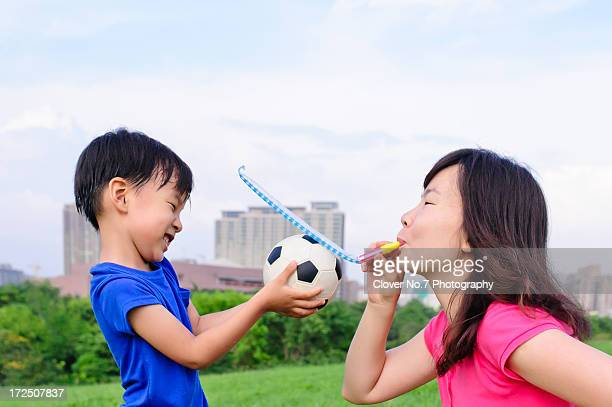 Asian mother and son playing game.
