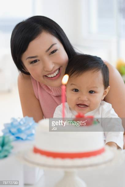 Asian mother celebrating baby's first birthday