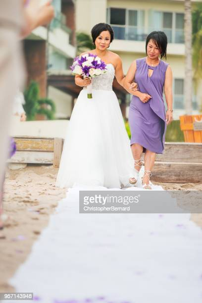 Asian mother walking the bride