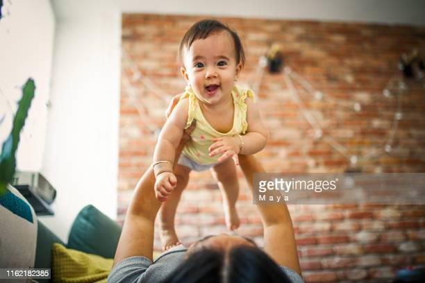 asian mother with baby - baby m stock pictures, royalty-free photos & images