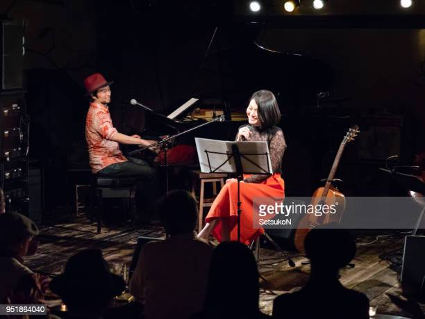asian musicians, pianist and guitarist, performing on stage - keyboard player stock photos and pictures