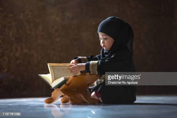 asian muslim children quran mosque respect islam hijab - beautiful ramadan stock pictures, royalty-free photos & images