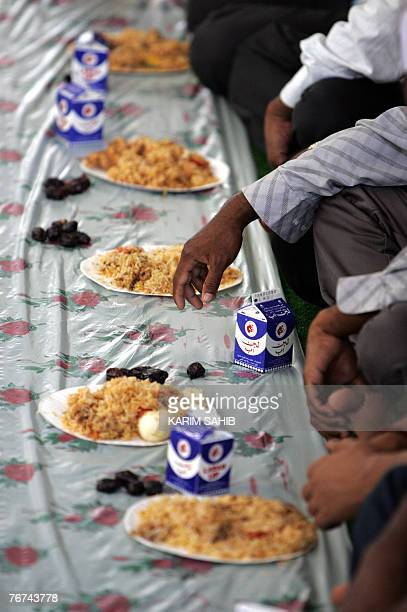 Asian Muslims break their fast in a food hall on the first Friday of the holy month of Ramadan in Dubai 14 September 2007 The world's 12 billion...