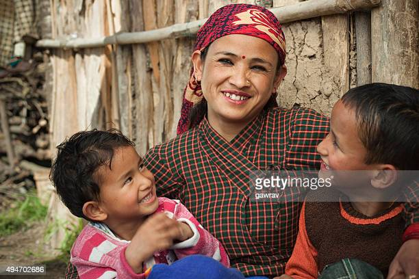 asian, nepalese, traditional happy peasant woman with her two children. - nepal stock pictures, royalty-free photos & images