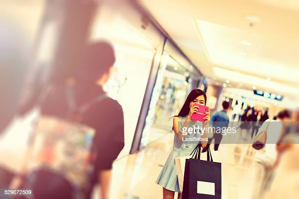 Asian nice young woman messaging on smart phone