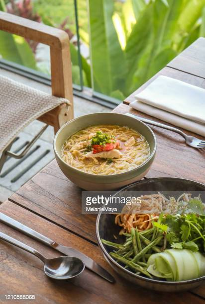 asian noodle soup with fresh herbs - traditionally cambodian stock pictures, royalty-free photos & images