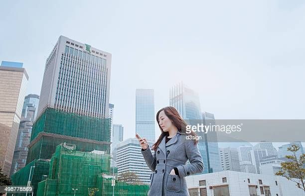 Asian office lady using smartphone in Central