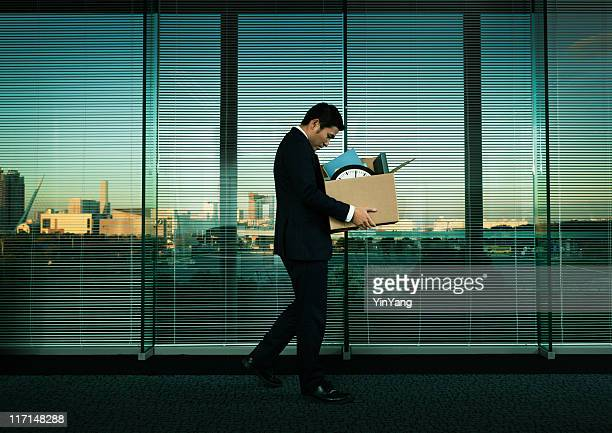 asian office worker leaving his job in layoff for recession - downsizing unemployment stock pictures, royalty-free photos & images