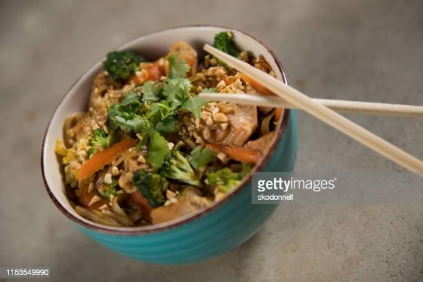 Asian pad Thai bowl with chopsticks