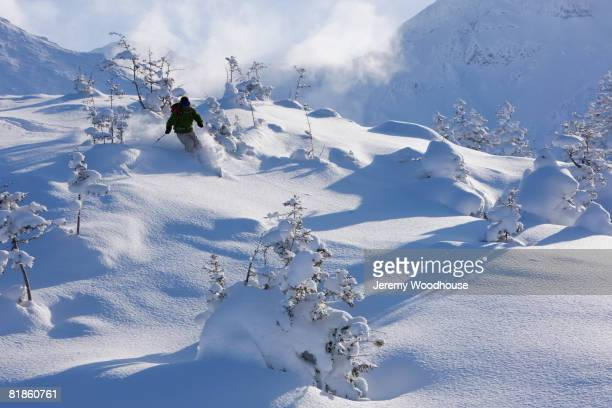 Asian person skiing