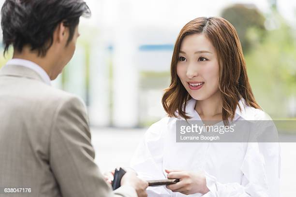 Asian Professional Woman Exchanges Business Cards with Financial Advisor Tokyo