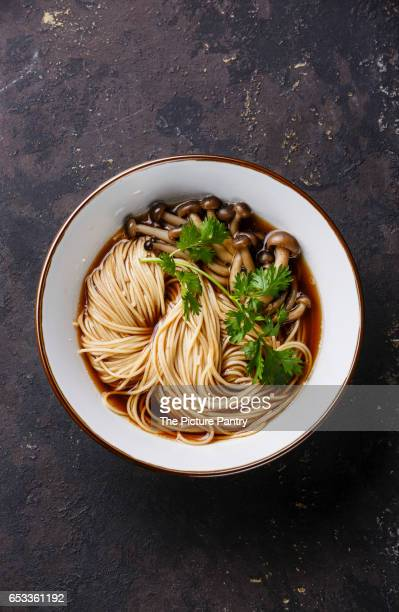 Asian Ramen noodles with shimidzhi mushrooms on dark background copy space