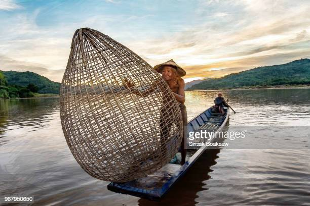 asian river fisherman lifestyle - mekong delta stock pictures, royalty-free photos & images