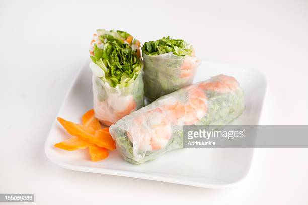 Asian roll sliced and displayed on white background